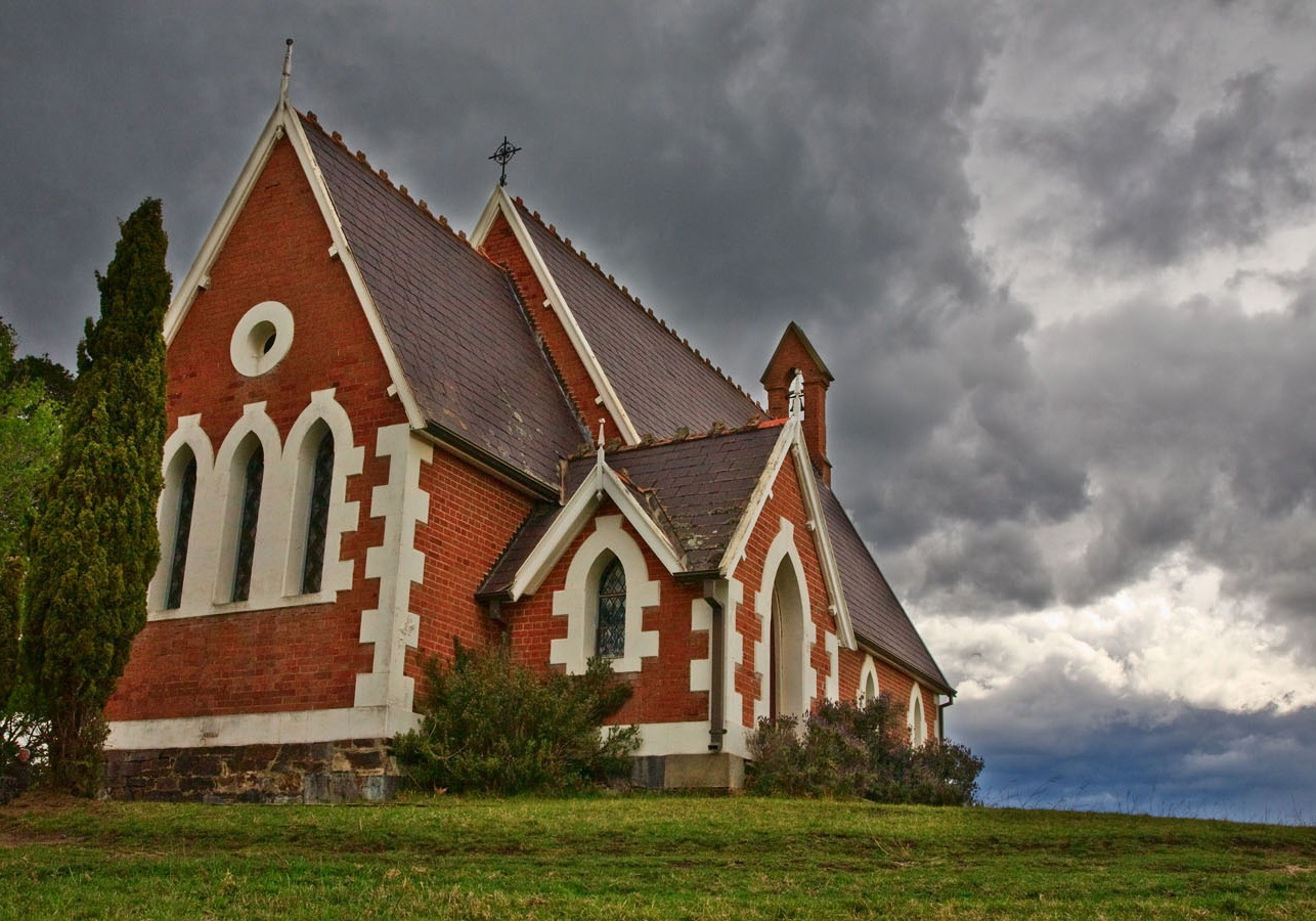 A church beneath storm clouds.