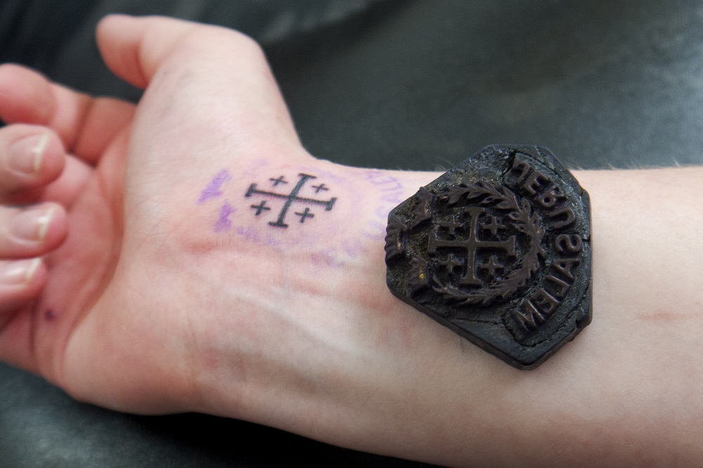 cad40a3d1 Meet A Family That Has Tattoed Christians In Jerusalem For 700 Years. '