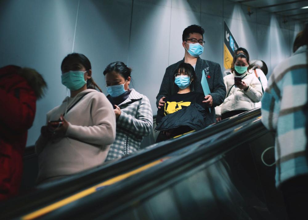 masks mask wearers on an escalator